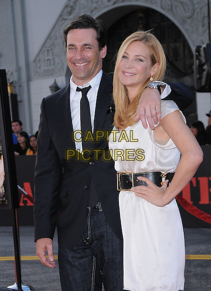 JON HAMM & JENNIFER WESTFELDT.L.A. Premiere of 'The A-Team' held at The Grauman's Chinese Theatre in Hollywood, California, USA. .June 3rd, 2010                       .half length suit dress belt hand on hip couple black white arm over shoulder .CAP/RKE/DVS.©DVS/RockinExposures/Capital Pictures.