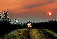 Riding at midnight  through Dalton Highway, Alaska. June 23, 2005. Born in Argentina, photographer Ivan Pisarenko in 2005  decided to ride his motorcycle across the American continent. While traveling Ivan is gathering an exceptional photographic document on the more diverse corners of the region. Archivolatino will publish several stories by this talented young photographer...