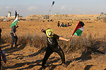 """Palestinian protesters clash with Israeli troops following the tents protest where Palestinians demand the right to return to their homeland at the Israel-Gaza border, in the southern Gaza Strip, April 19, 2019. The Palestinian health ministry in Gaza later said in a statement that 46 people were wounded by Israeli fire during border demonstrations, including """"five paramedics and four journalists"""". Photo by Ashraf Amra"""