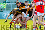 Mikey Geaney Dingle in action against Michael Burns and Gavin White of Dr. Crokes during the Kerry County Senior Club Football Championship Final match between Dr Crokes and Dingle at Austin Stack Park in Tralee, Kerry on Sunday.