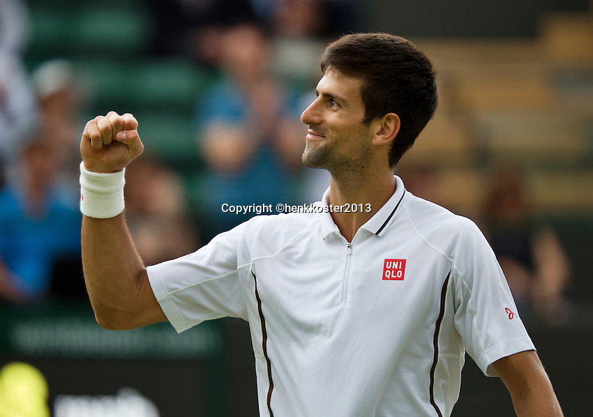 03-07-13, England, London,  AELTC, Wimbledon, Tennis, Wimbledon 2013, Day nine, Novak Djokovic (SRB) makes a fist to his coach after defeating Berdych in the quarterfinal<br /> <br /> <br /> <br /> Photo: Henk Koster