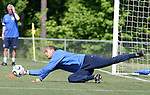 Tim Howard makes a save as goalkeeping coach Milutin Soskic (behind) watches on Saturday, May 20th, 2006 at SAS Soccer Park in Cary, North Carolina. The United States Men's National Soccer Team held a training session as part of their preparations for the upcoming 2006 FIFA World Cup Finals being held in Germany.