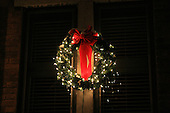 A light decorated Chrismas wreath at night