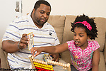 7 year old girl at home with father homework math subtraction flash cards using bead abacus