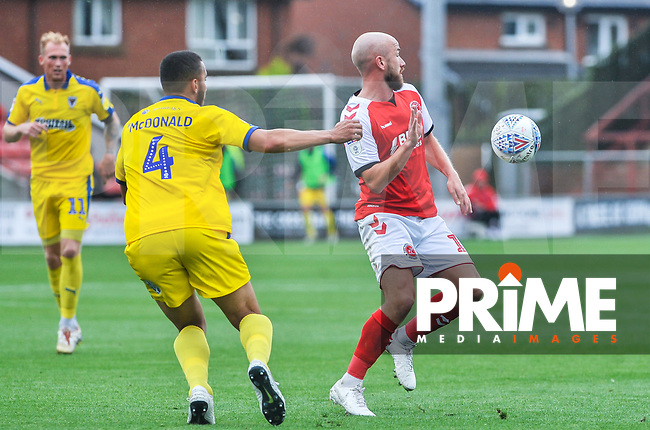 Fleetwood Town's forward Patrick Madden (17)  with Wimbledon's defender Rod McDonald (4) during the Sky Bet League 1 match between Fleetwood Town and AFC Wimbledon at Highbury Stadium, Fleetwood, England on 10 August 2019. Photo by Stephen Buckley / PRiME Media Images.
