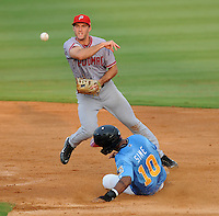Second baseman Steve Lombardozzi (4) of the Potomac Nationals throws to first for a double play after putting out Samuel Sime (10) of the Myrtle Beach Pelicans in a game on Aug. 7, 2010, at BB&T Coastal Field in Myrtle Beach, S.C. Photo by: Tom Priddy/Four Seam Images