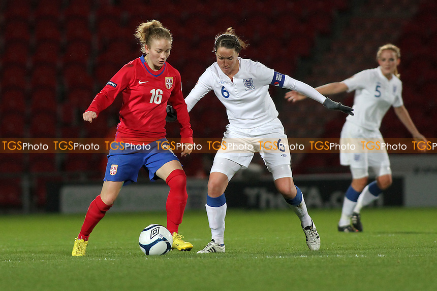 Casey Stoney of England and Indira Ilic of Serbia - England Women vs Serbia Ladies - UEFA Euro 2013 Group 6 Qualifier at Keepmoat Stadium, Doncaster Rovers FC - 23/11/11 - MANDATORY CREDIT: Gavin Ellis/TGSPHOTO - Self billing applies where appropriate - 0845 094 6026 - contact@tgsphoto.co.uk - NO UNPAID USE.