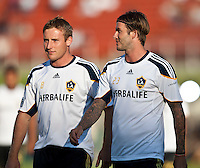 LOS ANGELES, CA – July 16, 2011: Chris Birchall (8) and David Beckham (23) of the LA Galaxy during the match between LA Galaxy and Real Madrid at the Los Angeles Memorial Coliseum in Los Angeles, California. Final score Real Madrid 4, LA Galaxy 1.