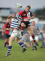 Harlequins winger Jonny Lowe battles for possession with Dungannon flanker Oisin Hennessy during the First Trust Senior Cup Final at Ravenhill. Result - Dungannon 27pts Harlequins 10pts.