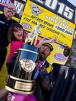 Nov 1, 2015; Las Vegas, NV, USA; NHRA top fuel driver Antron Brown (right) and wife Billie Brown react as they pose for a photo after clinching the 2015 top fuel dragster world championship during eliminations for the Toyota Nationals at The Strip at Las Vegas Motor Speedway. Mandatory Credit: Mark J. Rebilas-USA TODAY Sports