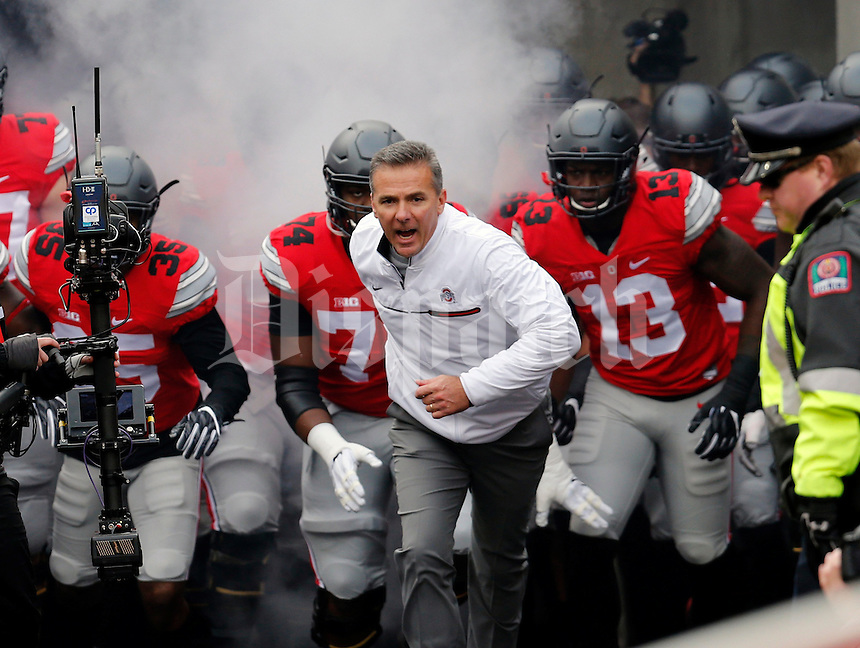 Ohio State Buckeyes head coach Urban Meyer and the Buckeyes take the field for their game against Michigan Wolverines at  Ohio Stadium in Columbus, Ohio on November 26, 2016.  (Kyle Robertson / The Columbus Dispatch)