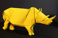 New York, NY, USA - June 22, 2012: An origami creation on display at the OrigamiUSA 2012 convention exhibition held at Fashion Institute of Technology in New York City. This Origami rhinoceros was designed and folded out of one sheet of square paper by Sipho Mabona, an Origami artist living in Switzerland. Mabona was a guest of honor at the convention.