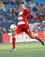 FC Dallas substitute forward Blas Perez (7) attempts to control long pass..  In a Major League Soccer (MLS) match, FC Dallas (red) defeated the New England Revolution (blue), 1-0, at Gillette Stadium on March 30, 2013.