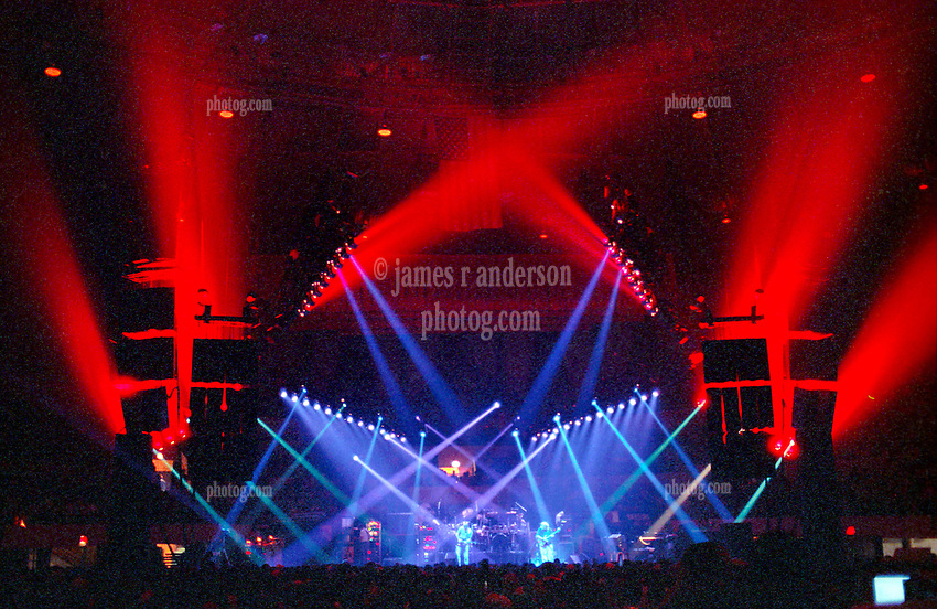 "Dramatic Lighting by Candace Brightman during the Grateful Dead Live Performance at the Hampton Coliseum on 8 October 1989. One of the Eleven images included in the CD boxed set release, ""Formerly The Warlocks"". Can be purchased individually or as part of a special limited set of all 11 in the package printed by the photographer. Choose in Cart."