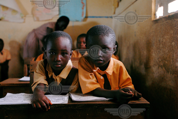 Schoolchildren listen in class at Abompekrom School.