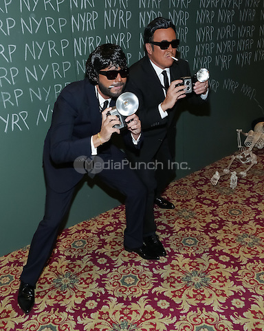 """NEW YORK, NY - OCTOBER 31 : Lance LePere (L) and Fashion Designer Michael Kors arrive for the New York Restoration Project's 19th Annual Hulaween Gala """"FELLINI HULAWEENI"""" held at the Waldorf Astoria on October 31, 2014 in New York City.  (Photo by Brent N. Clarke / MediaPunch)"""