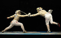Aug. 9, 2008; Beijing, CHINA; Becca Ward (left) battles Mariel Zagunis during the womens fencing individual sabre semi final at the Fencing Hall in the 2008 Beijing Olympic Games. Mandatory Credit: Mark J. Rebilas-