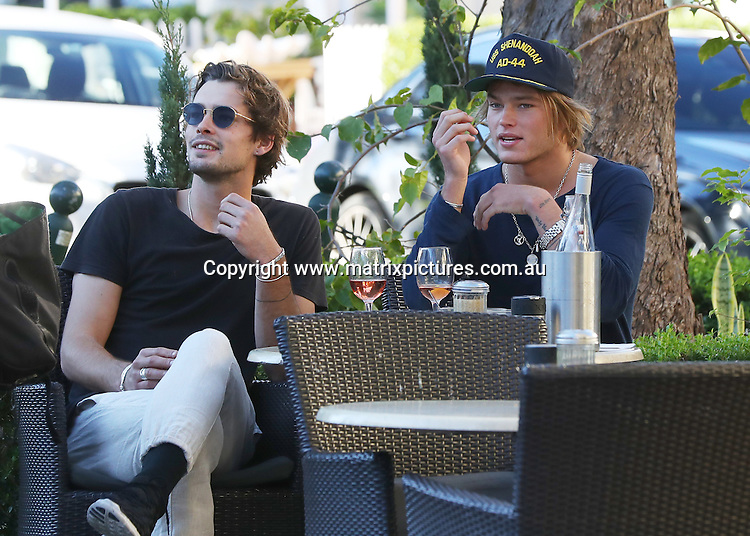 22 JUNE 2016 SYDNEY AUSTRALIA<br /> WWW.MATRIXPICTURES.COM.AU<br /> <br /> EXCLUSIVE PICTURES<br /> <br /> Jordan Barrett pictured with a friend having a glass of Rose at Indigo Cafe Double Bay<br /> <br /> *ALL WEB USE MUST BE CLEARED*<br /> <br /> Please contact prior to use:  <br /> <br /> +61 2 9211-1088 or email images@matrixmediagroup.com.au <br /> <br /> Note: All editorial images subject to the following: For editorial use only. Additional clearance required for commercial, wireless, internet or promotional use.Images may not be altered or modified. Matrix Media Group makes no representations or warranties regarding names, trademarks or logos appearing in the images.