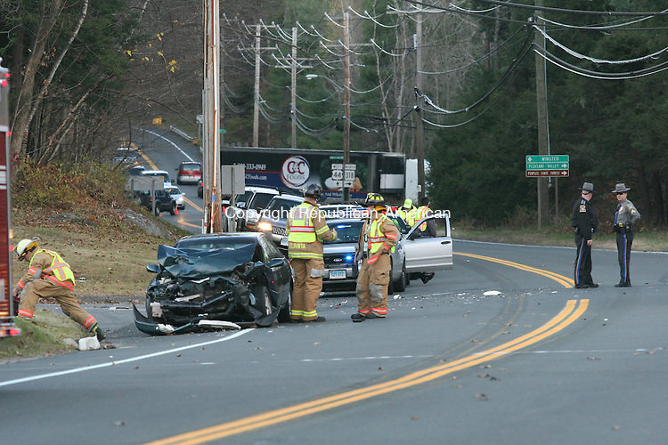 BARKHAMSTED, CT - 10 November, 2010 - 111010MO06 - Police said the Toyota Camry at left struck a minivan waiting to turn left from Route 44 into a gas station near Ripley Hill Road Wednesday afternoon. The impact propelled the minivan into a nearby home, which was not seriously damaged. The minivan's driver was airlifted to a Hartford area hospital, while two young female occupants of the Toyota were taken by ambulance to Winsted Health Center. Jim Moore Republican-American.