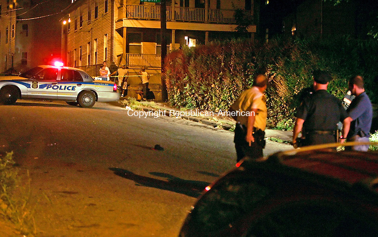 WATERBURY, CT - 06 AUGUST 2005 -080605JS09-- Waterbury police investigate a late night shooting on Lounsbury Street near South Street in Waterbury.  --Jim Shannon Photo--are CQ