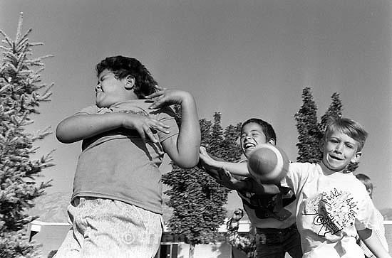Kids playing football.<br />