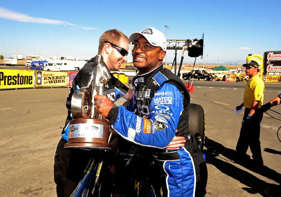 Jul. 31, 2011; Sonoma, CA, USA; NHRA top fuel dragster driver Antron Brown celebrates with a crew member after winning the Fram Autolite Nationals at Infineon Raceway. Mandatory Credit: Mark J. Rebilas-