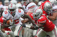 Ohio State Buckeyes running back Bri'onte Dunn (25) is grabbed by Ohio State Buckeyes defensive lineman J.T. Moore (50) as he tries to find an opening during the Ohio State Buckeyes Scarlet vs Grey spring game Saturday morning, April 21, 2012. The Scarlet team defeated the Gray team 20 - 14.  (The Columbus Dispatch / Eamon Queeney)