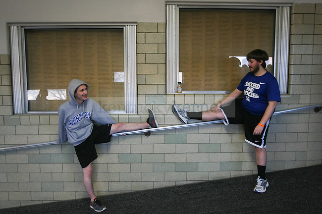 Sophomore computer science major Jared Becker (left) and junior economics and digital and mass communication major Brenton Smith (right) pause to stretch at Dance Blue at Memorial Coliseum in Lexington, Ky., on Sunday, February 15, 2015. Photo by Cameron Sadler | Staff