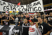 "DC United Marco Etcheverry is presented by fans from Barra Brava with a plaque honoring him, and in the back a banner that reads ""The Barra Brava is with you"". DC United 1997 defeated United of Hollywood 2-1 in a game honoring former DC United forward Bolivian Marco Etcheverry at RFK Stadium in Washington DC, Saturday October 20, 2007."