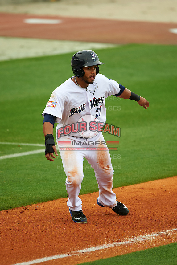Pensacola Blue Wahoos outfielder Juan Silva (27) leads off third during the second game of a double header against the Biloxi Shuckers on April 26, 2015 at Pensacola Bayfront Stadium in Pensacola, Florida.  Pensacola defeated Biloxi 2-1.  (Mike Janes/Four Seam Images)