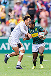 Mfundo Ndhlovu of South Africa (R) fights Ryan Olowofela of England (L) during the HSBC Hong Kong Sevens 2018 match between South Africa and England on April 7, 2018 in Hong Kong, Hong Kong. Photo by Marcio Rodrigo Machado / Power Sport Images