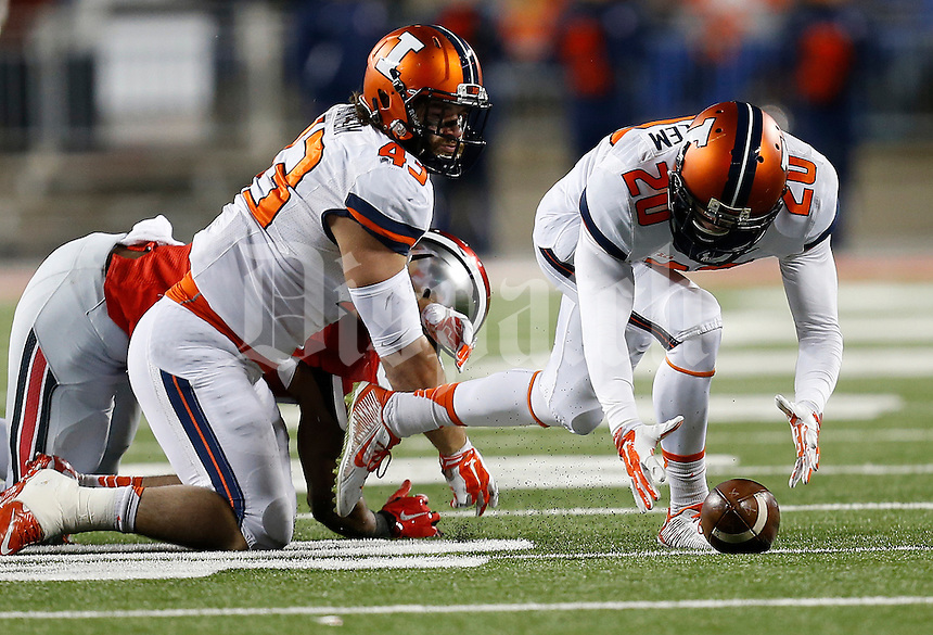 Illinois Fighting Illini defensive back Clayton Fejedelem (20) recovers a fumble caused by Illinois Fighting Illini linebacker Mason Monheim (43) in the fourth quarter the college football game between the Ohio State Buckeyes and the Illinois Fighting Illini at Ohio Stadium in Columbus, Saturday night, November 1, 2014. The Ohio State Buckeyes defeated the Illinois Fighting Illini 55 - 14. (The Columbus Dispatch / Eamon Queeney)