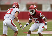 Hawgs Illustrated/BEN GOFF <br /> Jarques McClellion (4), Arkansas cornerback, lines up against Deon Stewart, Arkansas wide receiver, in the second quarter Saturday, April 6, 2019, during the Arkansas Red-White game at Reynolds Razorback Stadium.