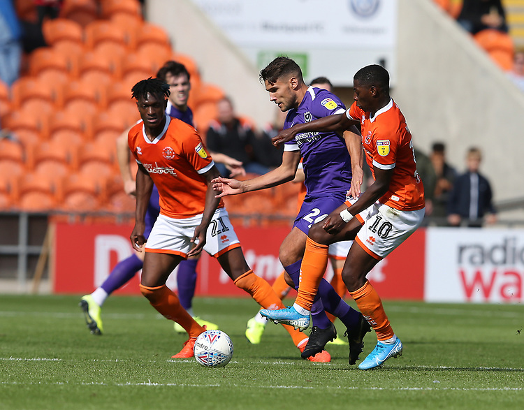 Blackpool's Armand Gnanduillet (left) and Sullay Kaikai battles with Portsmouth's Gareth Evans<br /> <br /> Photographer Stephen White/CameraSport<br /> <br /> The EFL Sky Bet League One - Blackpool v Portsmouth - Saturday 31st August 2019 - Bloomfield Road - Blackpool<br /> <br /> World Copyright © 2019 CameraSport. All rights reserved. 43 Linden Ave. Countesthorpe. Leicester. England. LE8 5PG - Tel: +44 (0) 116 277 4147 - admin@camerasport.com - www.camerasport.com