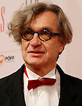EFA president WIM WENDERS poses for the media as he arrives at 23rd European Film Awards