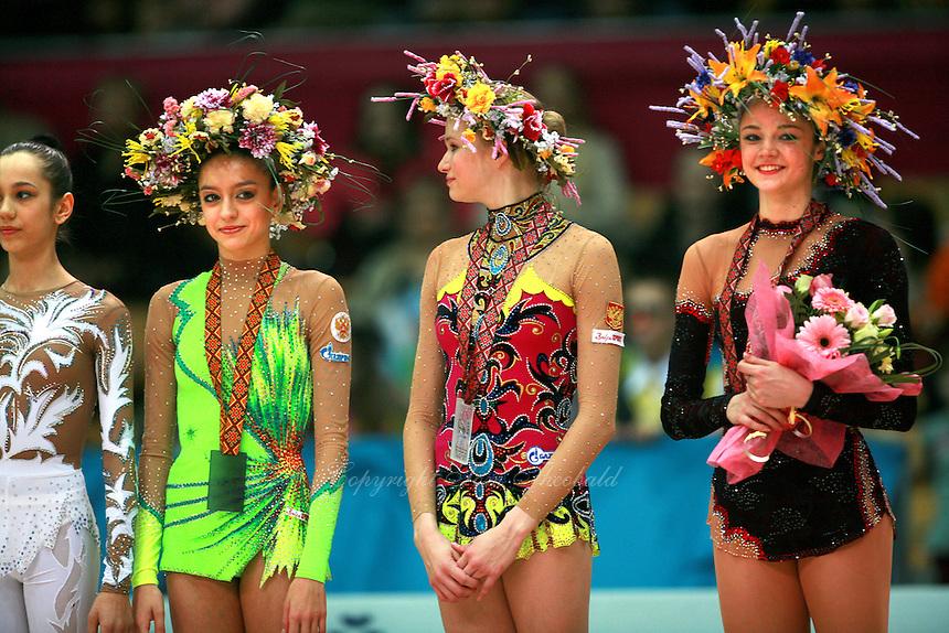 "(L-R) Evgenia Kanaeva, Olga Kapranova of Russia, Anna Bessonova of Ukraine smile  during All-Around awards ceremony at 2007 World Cup Kiev, ""Deriugina Cup"" in Kiev, Ukraine on March 17, 2007. Anna Bessonova won the seniors All-Around."