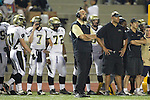 Torrance, CA 11/05/10 - Coach Adam Boyd and Coach Jim Canetti in action during the Peninsula vs West varsity football game played at West Torrance high school.