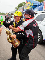 Aug 19, 2018; Brainerd, MN, USA; NHRA top fuel driver Billy Torrence (left) celebrates with crew member Bobby Lagana after winning the Lucas Oil Nationals at Brainerd International Raceway. Mandatory Credit: Mark J. Rebilas-USA TODAY Sports