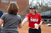 GREENSBORO, NC - MARCH 11: Head coach Christina Sutcliffe of Northern Illinois University shakes hands with head coach Janelle Breneman of UNC Greensboro during a game between Northern Illinois and UNC Greensboro at UNCG Softball Stadium on March 11, 2020 in Greensboro, North Carolina.