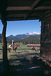Cowboy saddled up in the corral, MacGregor Ranch, Estes Park, CO