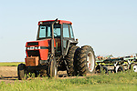 Mid 1980s Case IH 2294 tractor in filed with disc harrow