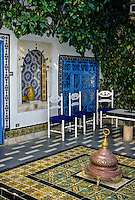 Tunisia, Sidi Bou Said.  Floor Tiles Decorate an Inner Courtyard of Dar Annabi, a Private Home open for Public Viewing.  Originally constructed 18th. century, remodeled 20th. century.  The orange, black, and white tile is known as the Lion's Paw design.