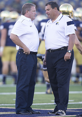September 06, 2014:  Notre Dame head coach Brian Kelly  and Michigan head coach Brady Hoke during NCAA Football game action between the Notre Dame Fighting Irish and the Michigan Wolverines at Notre Dame Stadium in South Bend, Indiana. Notre Dame defeated Michigan 31-0.
