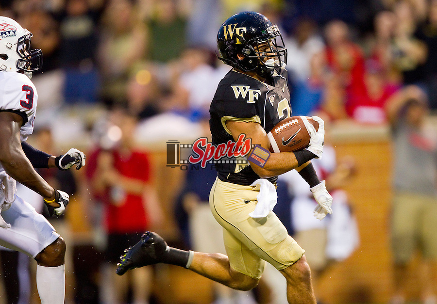 Michael Campanaro #3 of the Wake Forest Demon Deacons gets behind the Liberty Flame defense to score on a 31-yard pass play at BB&T Field on September 1, 2012 in Winston Salem, North Carolina.  The Demon Deacons defeated the Flames 20-17.  (Brian Westerholt/Sports On Film)