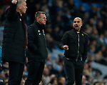 Josep Guardiola manager of Manchester City looks towards David Moyes manager of West Ham United during the premier league match at the Etihad Stadium, Manchester. Picture date 3rd December 2017. Picture credit should read: Andrew Yates/Sportimage