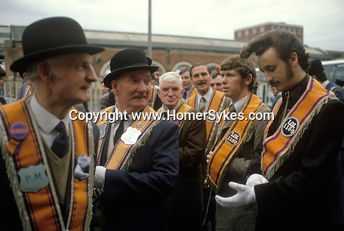 Old and young Protestant Orangemen at an Orange Day Parade Belfast  Ireland. 1980s.<br />
