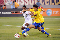 Robbie Findley (20) of the United States and Carlos Eduardo (16)  of Brazil battle for the ball. The men's national team of Brazil (BRA) defaeted the United States (USA) 2-0 during an international friendly at the New Meadowlands Stadium in East Rutherford, NJ, on August 10, 2010.