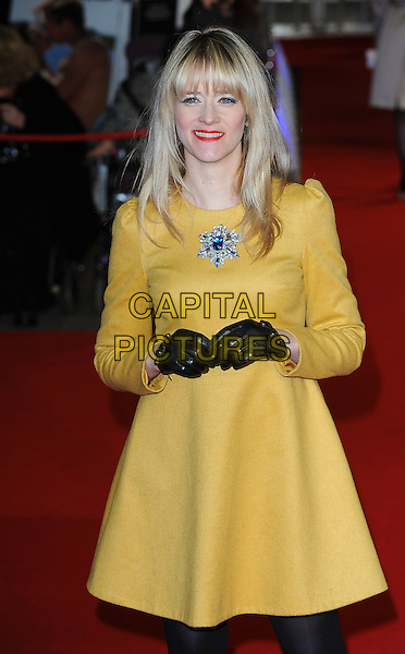 Edith Bowman.'W.E.' UK film premiere at Odeon cinema, Kensington, London, England..11th January 2011.half length dress black gloves yellow star brooch blue red lipstick fringe bangs hair .CAP/BEL.©Tom Belcher/Capital Pictures.