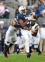 01 November 2014:  Penn State WR Eugene Geno Lewis (7) catches a pass while Maryland S Sean Davis (21) defends. The Maryland Terrapins defeated the Penn State Nittany Lions 20-19 at Beaver Stadium in State College, PA.