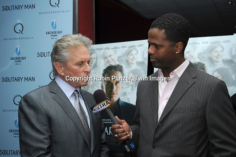 "Michael Douglas  and AJ Calloway attending  The New York Premiere of ""Solitary Man"" starring Michael Douglas, Jenna Fischer, Imogen Poots at Cinema 2 on May 11, 2010 in New York City."